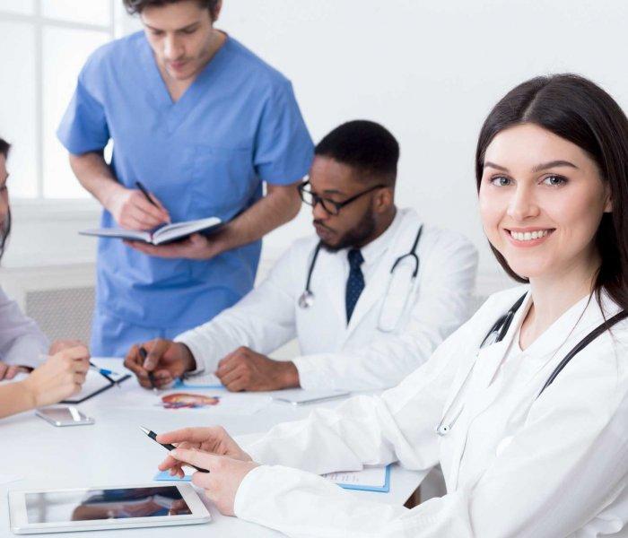 team-of-doctors-having-meeting-in-medical-office-24TWHC6.jpg